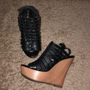 Black leather wedges
